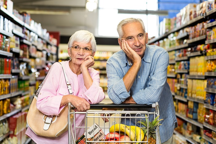 Senior couple shopping together in supermarket